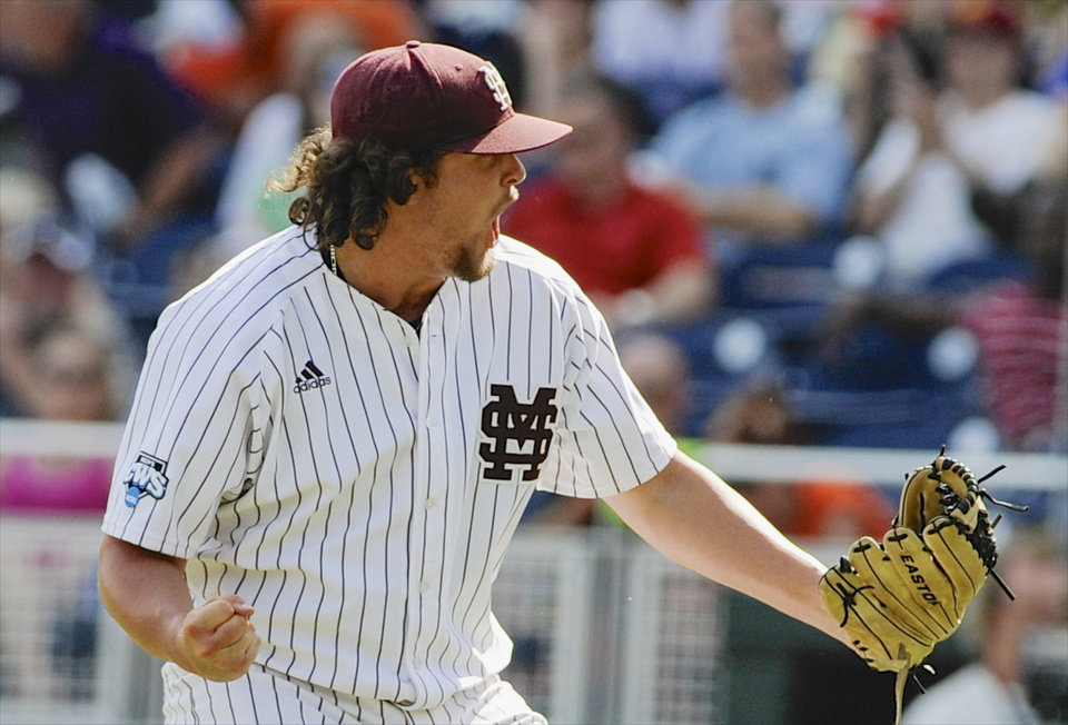 Photo - Mississippi State closing pitcher Jonathan Holder reacts after the final out against Oregon State in an NCAA College World Series baseball game in Omaha, Neb., Friday, June 21, 2013. Mississippi State won 4-1 and will play in the championship series. (AP Photo/Eric Francis)