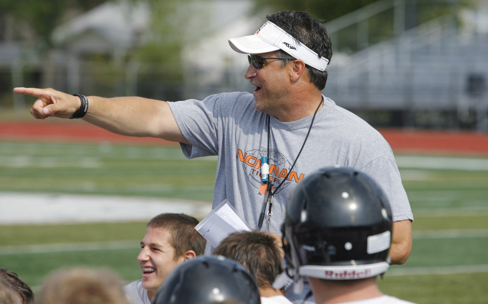 Photo - Norman High School Tiger football head coach Greg Nation points out exemplary behavior after practice on Wednesday, August 10, 2011, in Norman, Okla.  Photo by Steve Sisney, The Oklahoman