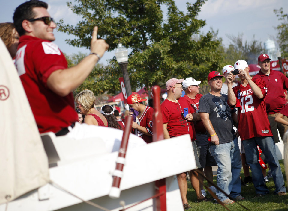 Fans take photos of the Sooner Schooner before the college football game between the University of Oklahoma Sooners (OU) and the Tulsa University Hurricanes (TU) at the Gaylord Family-Memorial Stadium on Saturday, Sept. 3, 2011, in Norman, Okla. 