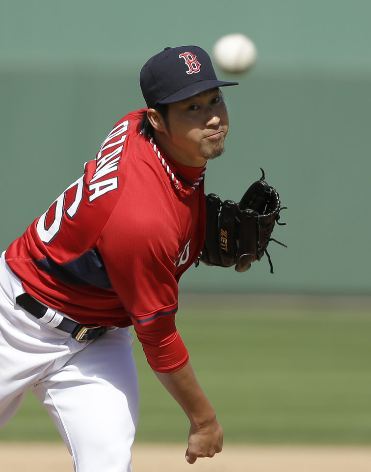Photo - Boston Red Sox pitcher Junichi Tazawa, of Japan, delivers a warm-up throw in the sixth inning of an exhibition baseball game against the Atlanta Braves, Friday, March 7, 2014, in Fort, Myers, Fla. (AP Photo/Steven Senne)