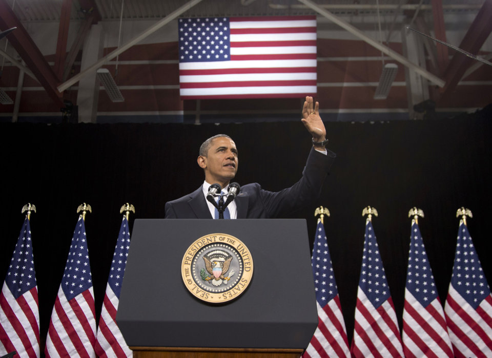 Photo - President Barack Obama waves as he arrives to speak about immigration at Del Sol High School, Tuesday, Jan. 29, 2013, in Las Vegas. (AP Photo/Carolyn Kaster)