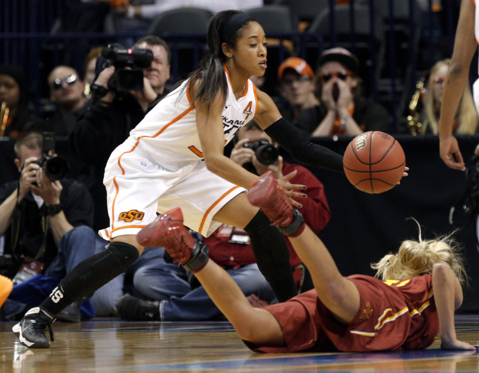Photo - Oklahoma State's Tiffany Bias (3) grabs a loose ball from Iowa State's Jadda Buckley (11) during the Women's Big 12 basketball tournament at  Chesapeake Energy Arena  in Oklahoma City, Okla., Saturday, March 8, 2014. Photo by Sarah Phipps, The Oklahoman