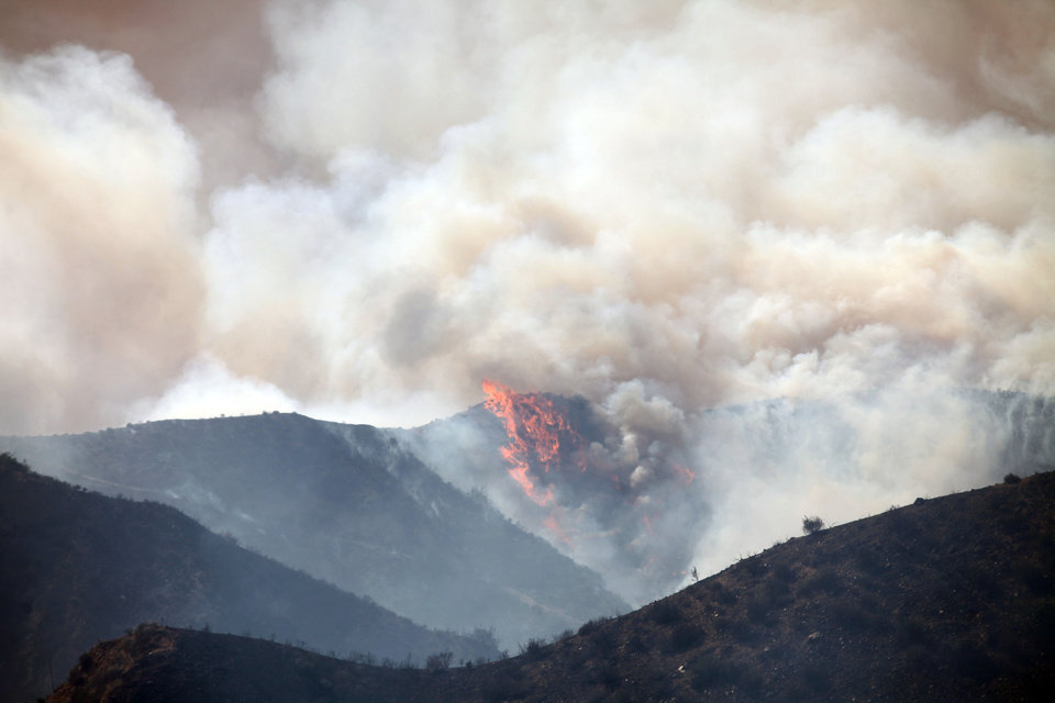 A wildfire burns in the Banning Bench area of Riverside county on Wednesday, May 1, 2013 in Banning, Calif. (AP Photo/The Desert Sun, Richard Lui)