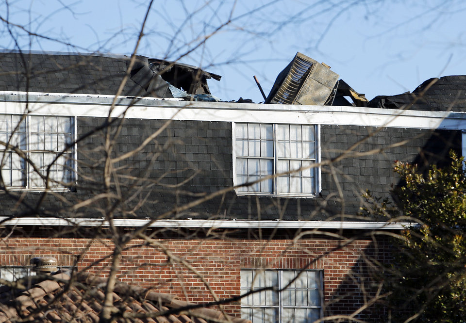 Photo - Significant attic and roof damage were caused by a fire at the Alpha Gamma Delta Sorority house near the University of Oklahoma in Norman.  Photo by Steve Sisney, The Oklahoman  STEVE SISNEY - THE OKLAHOMAN