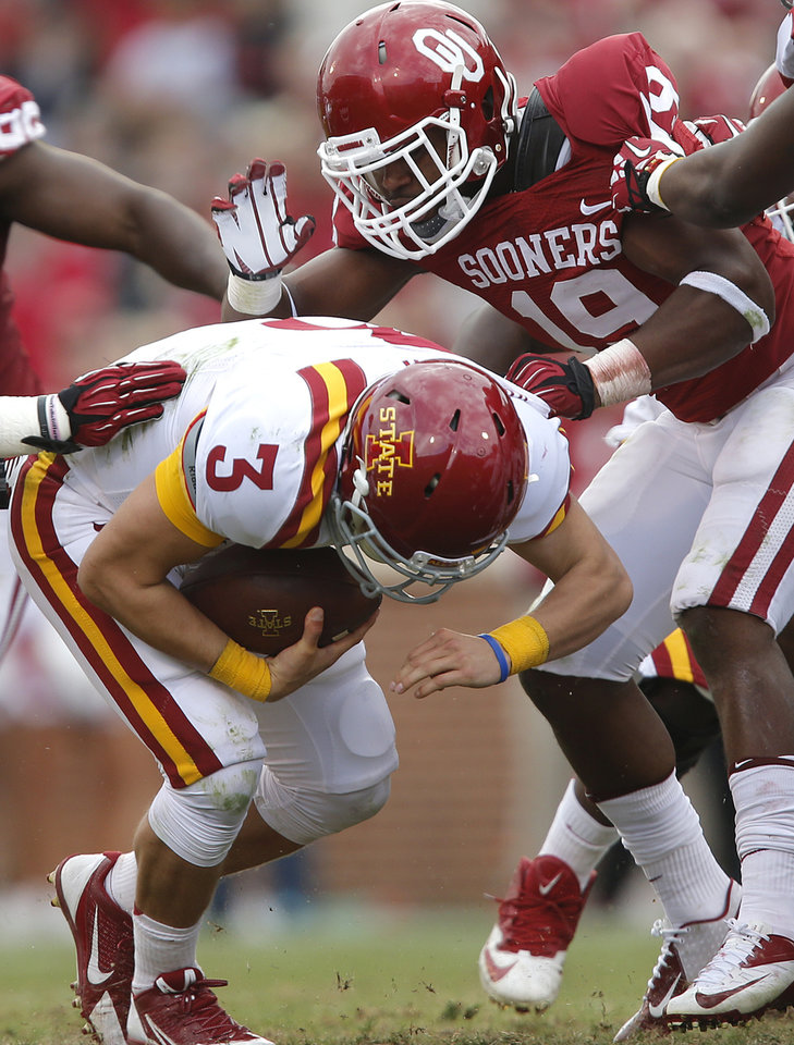 Oklahoma's Eric Striker (19) stops Iowa State's Grant Rohach (3) during the college football game between the University of Oklahoma Sooners (OU) and the Iowa State University Cyclones (ISU) at Gaylord Family-Oklahoma Memorial Stadium in Norman, Okla. on Saturday, Nov. 16, 2013. Photo by Chris Landsberger, The Oklahoman