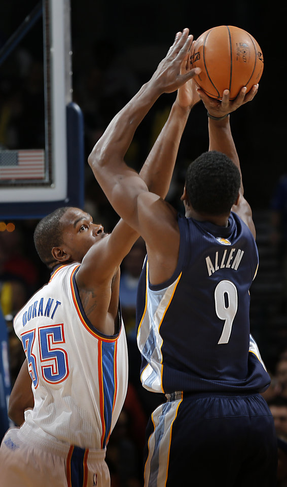 Photo - Oklahoma City's Kevin Durant (35) defends on Memphis' Tony Allen (9)  during the NBA basketball game between the Oklahoma City Thunder and the Memphis Grizzlies at Chesapeake Energy Arena on Wednesday, Nov. 14, 2012, in Oklahoma City, Okla.   Photo by Chris Landsberger, The Oklahoman
