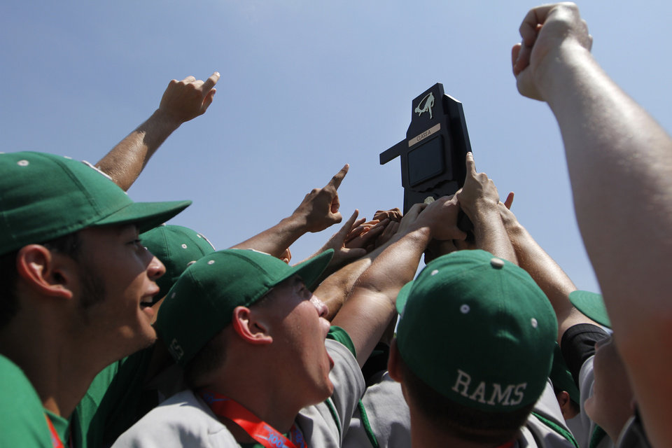 The Rattan Rams hold up their championship trophy after winning the Class A State Championship against Amber-Pocasset at Dolese Park in Oklahoma City, Saturday, May 5, 2012. Photo by Garett Fisbeck, For The Oklahoman