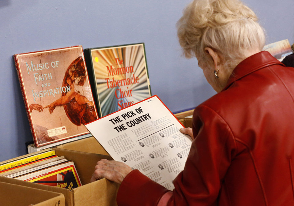A woman shops for vinyl records. Several thousand bibliophiles and bargain hunters crowded into Oklahoma Expo Hall at State Fair Park on Saturday, Feb. 23, 2013,  in a quest to find reading material  at deeply discounted  prices.  Friends of the Metropolitan Library System is holding their much-anticipated annual book sale this weekend. The sale continues Sunday from 9 a.m. to 5:30 p.m.   Photo by Jim Beckel, The Oklahoman