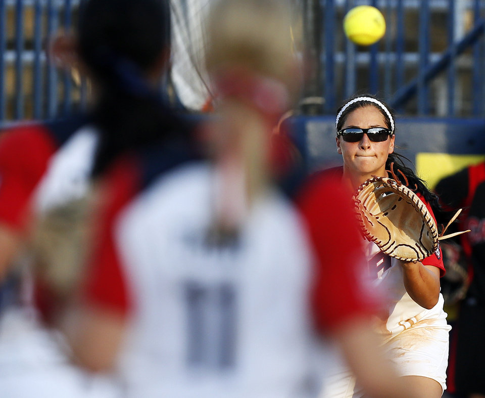 Photo - Lauren Chamberlain (44) of the United States makes a catch at first base for an out in the second inning during a game between Team USA and Canada in the World Cup of Softball at ASA Hall of Fame Stadium in Oklahoma City, Thursday, July 11, 2013. Team USA won 7-0 in 6 innings. Photo by Nate Billings, The Oklahoman