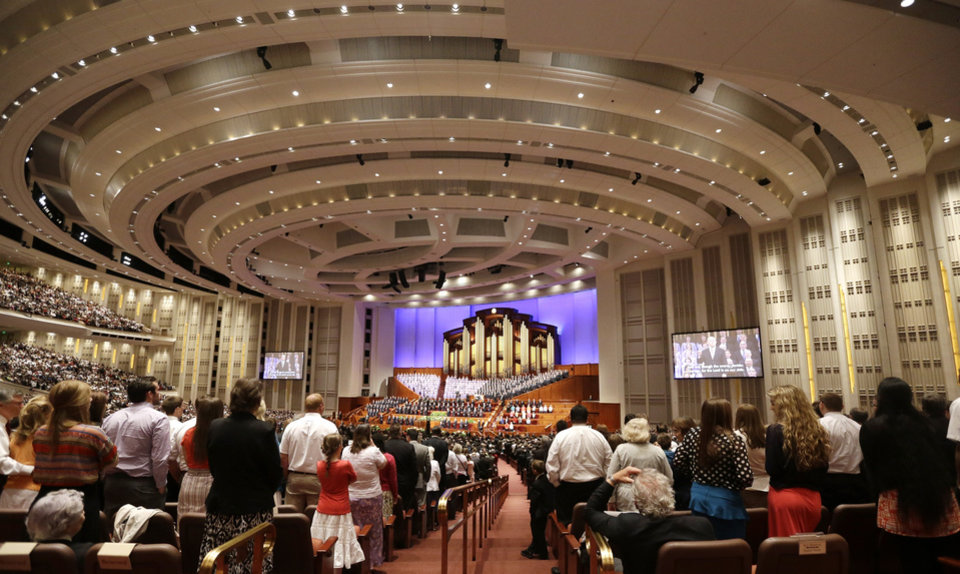 Photo - People gather inside the Conference Center during the 183rd Annual General Conference of The Church of Jesus Christ of Latter-day Saints Saturday, April 6, 2013, in Salt Lake City. The Mormon church is planning to build two new temples in Rio de Janeiro and Cedar City, Utah. The faith's president, Thomas S. Monson, announced the new temples on Saturday during the 183rd semi-annual general conference of The Church of Jesus Christ of Latter-day Saints. More than 100,000 members of the church have gathered in Salt Lake City to hear words of inspiration and guidance for daily living from the faith's senior leaders.  (AP Photo/Rick Bowmer)