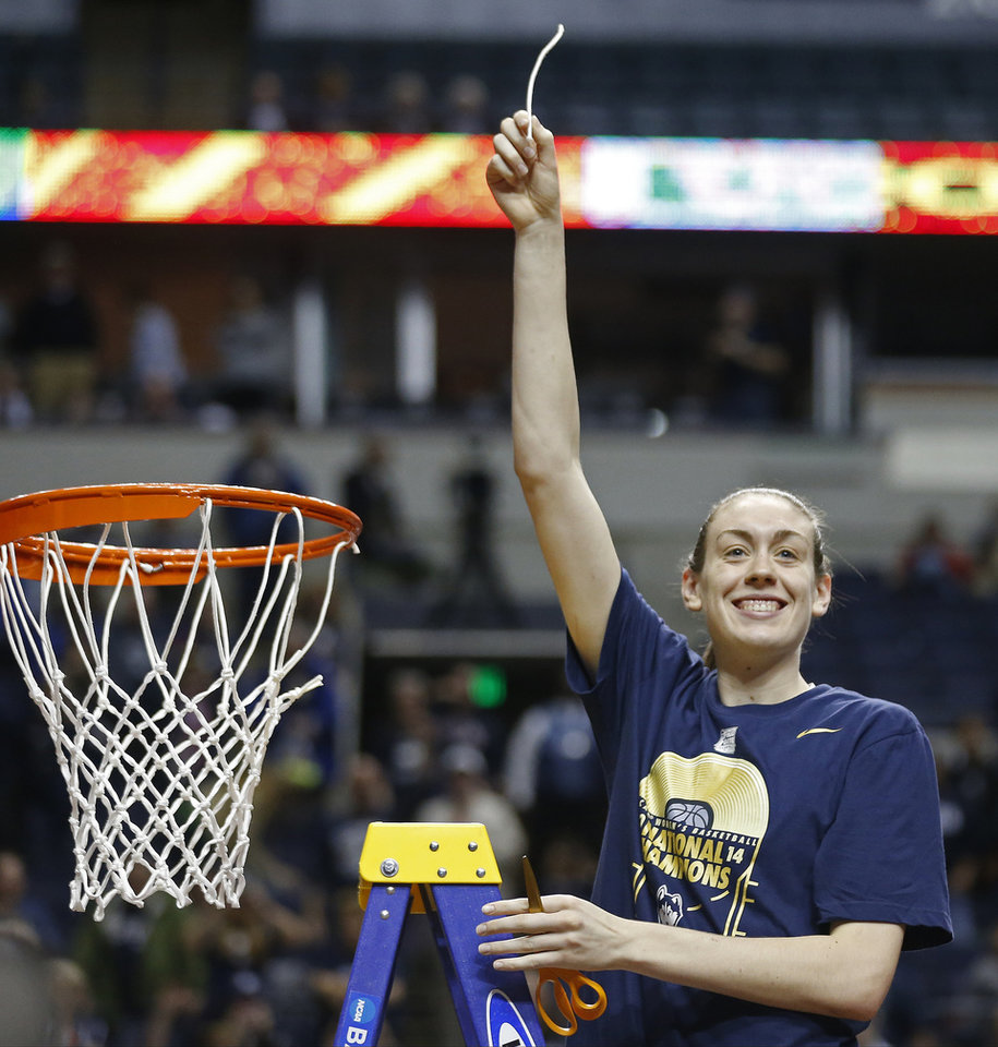 Photo - Connecticut forward Breanna Stewart holds the net after the second half of the championship game against Notre Dame in the Final Four of the NCAA women's college basketball tournament, Tuesday, April 8, 2014, in Nashville, Tenn. Connecticut won 79-58. (AP Photo/John Bazemore)