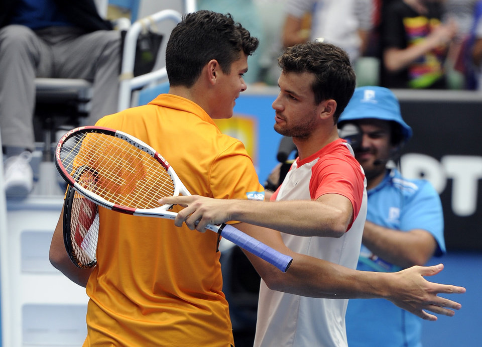 Photo - Grigor Dimitrov of Bulgaria, right, is congratulated by Milos Raonic of Canada at the net after he won their third round match at the Australian Open tennis championship in Melbourne, Australia, Saturday, Jan. 18, 2014.(AP Photo/Andrew Brownbill)