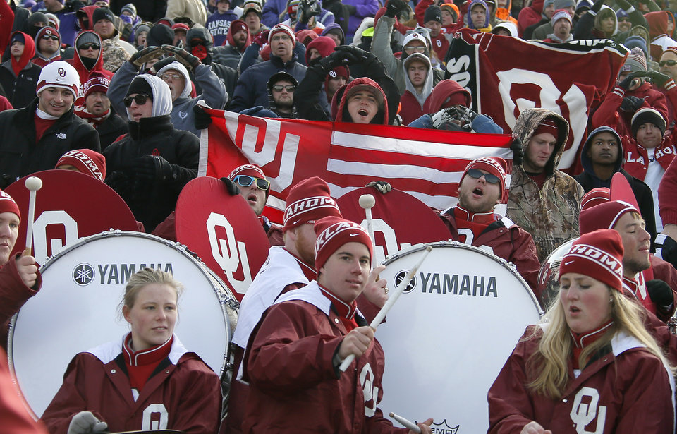 Oklahoma fans celebrate behind the band during an NCAA college football game between the Oklahoma Sooners and the Kansas State University Wildcats at Bill Snyder Family Stadium in Manhattan, Kan., Saturday, Nov. 23, 2013. Oklahoma won 41-31. Photo by Bryan Terry, The Oklahoman