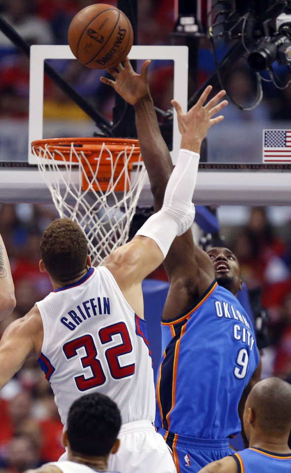 Photo - Oklahoma City's Serge Ibaka (9) blocks the shot of Los Angeles' Blake Griffin (32) during Game 3 of the Western Conference semifinals in the NBA playoffs between the Oklahoma City Thunder and the Los Angeles Clippers at the Staples Center in Los Angeles, Friday, May 9, 2014. Photo by Nate Billings, The Oklahoman