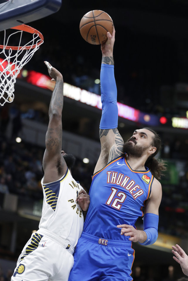 Photo - Oklahoma City Thunder center Steven Adams (12) misses a dunk over Indiana Pacers forward JaKarr Sampson during the first half of an NBA basketball game in Indianapolis, Tuesday, Nov. 12, 2019. (AP Photo/Michael Conroy)