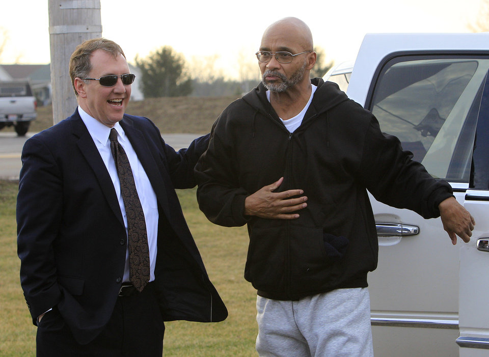 Photo - Doug Prade, right, a former Ohio police captain who has spent nearly 15 years in prison for his ex-wife's killing, is greeted by his attorney Mark Godsey after being released from the Madison Correctional Institution Tuesday, Jan. 29, 2013, in London, Ohio. Prade was exonerated by DNA testing. (AP Photo/Jay LaPrete)