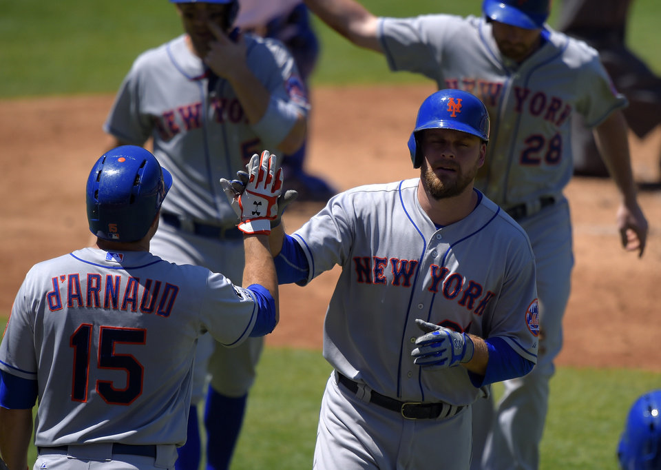Photo - New York Mets' Lucas Duda, right, is congratulated by teammate Travis d'Arnaud, left, after hitting a three-run home run during the third inning of a baseball game against the Los Angeles Dodgers, Sunday, Aug. 24, 2014, in Los Angeles. (AP Photo/Mark J. Terrill)