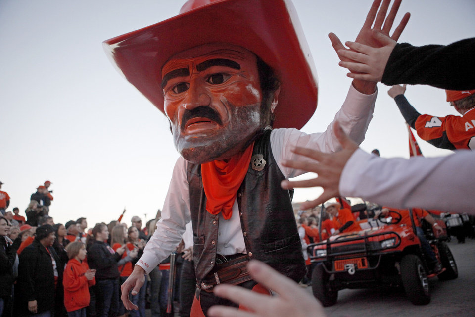 Photo - OSU mascot Pistol Pete greets fans during the Spirit Walk before the Bedlam college football game between the University of Oklahoma Sooners (OU) and the Oklahoma State University Cowboys (OSU) at Boone Pickens Stadium in Stillwater, Okla., Saturday, Nov. 27, 2010. Photo by Bryan Terry, The Oklahoman