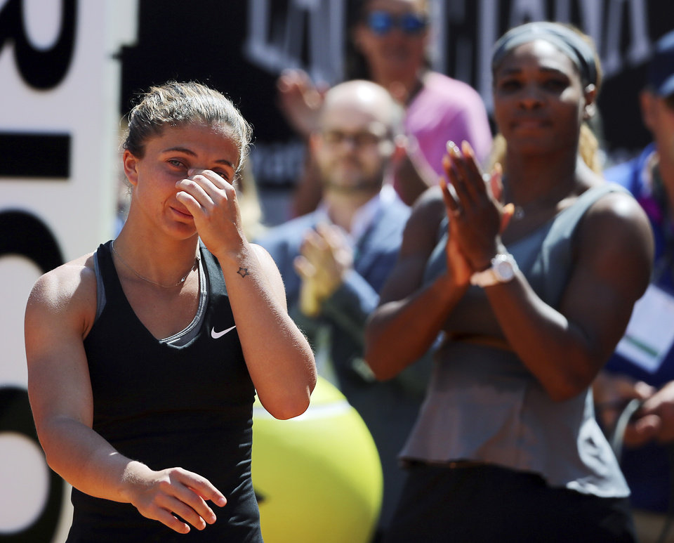 Photo - Italy's Sara Errani, left, walks past Serena Williams at the end of their final match at the Italian open tennis tournament in Rome, Sunday, May 18, 2014. Serena Williams kept the crowd from being a factor in a 6-3, 6-0 victory over 10th-seeded Sara Errani to win the Italian Open for the third time Sunday. (AP Photo/Gregorio Borgia)