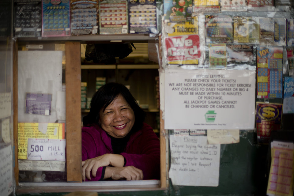 Photo -   Norn Phneo, 62, who sells Powerball tickets at her newsstand, poses for a photograph Wednesday, Nov. 28, 2012, in Philadelphia. (AP Photo/Matt Rourke)