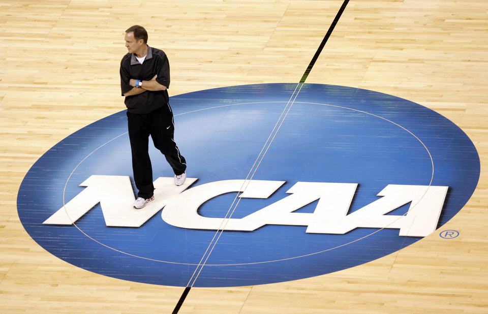 Photo - UNLV head coach Lon Kruger watches his team during the practice and press conference day for the NCAA Men's basketball tournament first and second rounds at the Ford Center in Oklahoma City, Wednesday, March 17, 2010. Photo by Nate Billings, The Oklahoman
