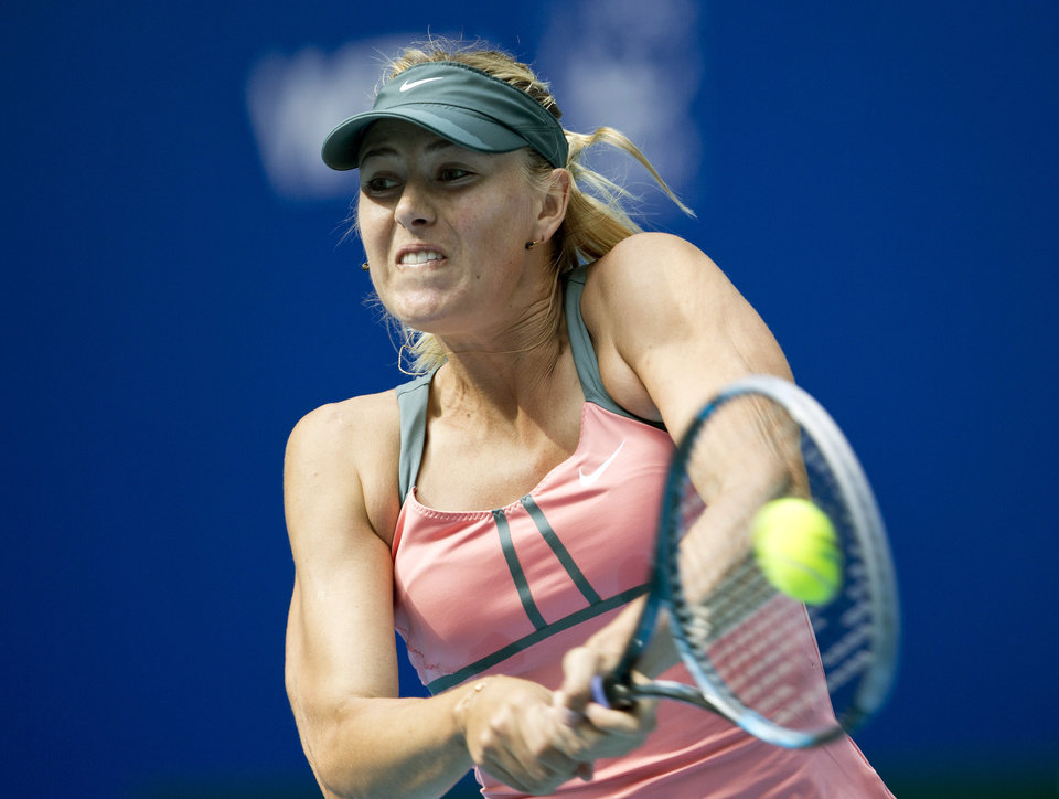 Photo -   Russia's Maria Sharapova hits a backhand shot to Polona Hercog of Slovenia during their women's singles tennis match of the China Open tennis tournament in Beijing Thursday, Oct. 4, 2012. Sharapova defeated Hercog 6-0, 6-2. (AP Photo/Andy Wong)