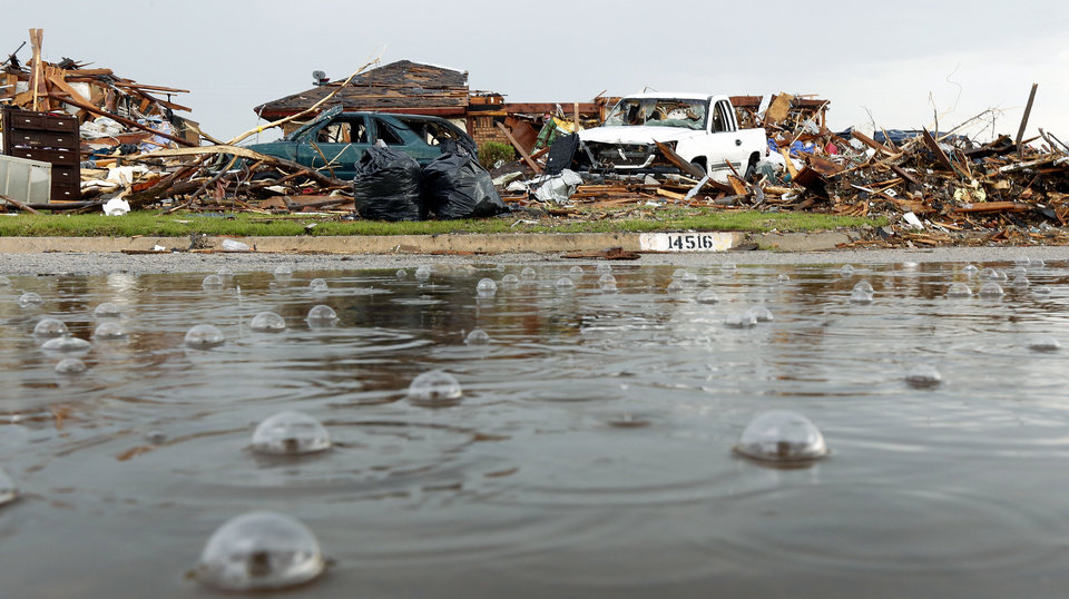 Rain falls on homes damaged by Monday's massive tornado on Brent Dr. in Oklahoma City , Thursday May 23, 2013.Photo By Steve Gooch, The Oklahoman