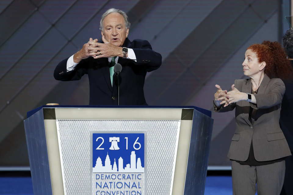 Photo - Former Sen. Tom Harkin, D-Iowa, uses sign language as he speaks during the second day of the Democratic National Convention in Philadelphia , Tuesday, July 26, 2016. (AP Photo/J. Scott Applewhite)