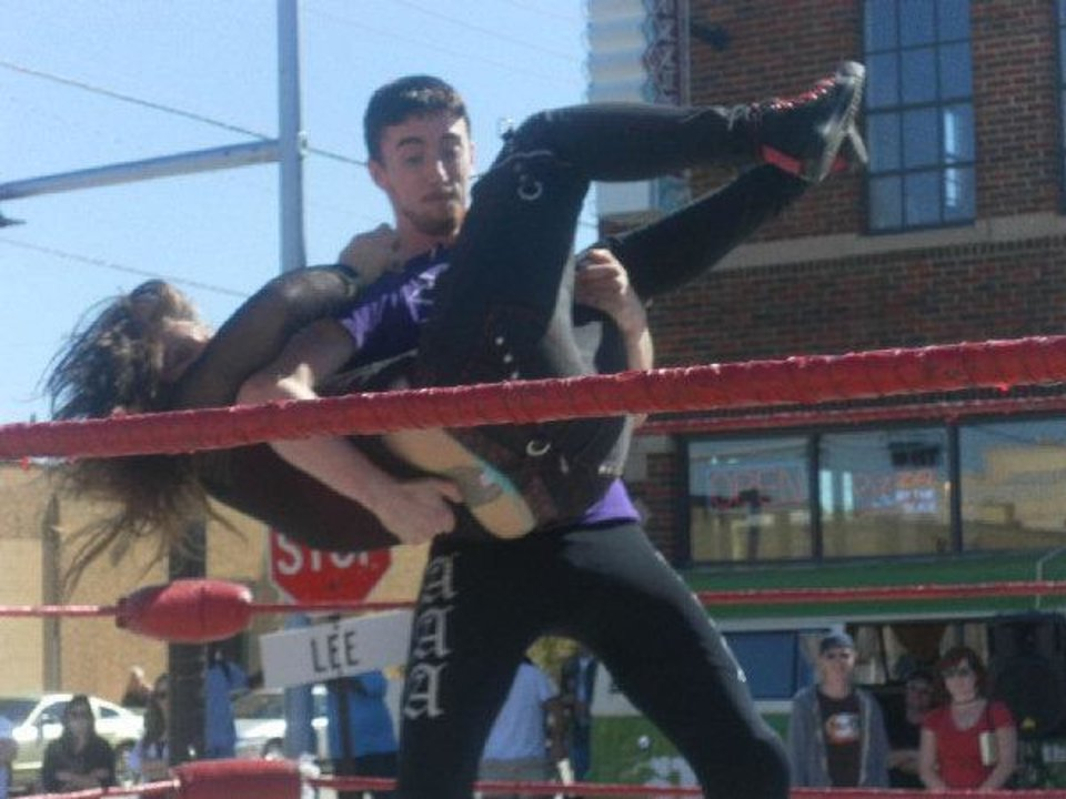 Photo - Dalton Bragg body-slams his female opponent Rose Thorn. This was one of many wrestling matches at the MANifesto arts festival. The festival was closed early due to lack of public interest.   Special to The Oklahoman - By Danniel Parker