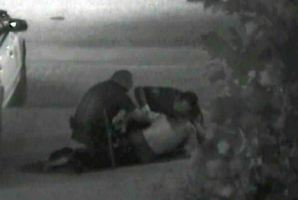 Photo -   This still photo taken from a security camera released on Monday May 7,2012 by the Orange County District Attorney shows an altercation between Fullerton police officers and homeless Kelly Thomas at the Fullerton bus depot on July 5,2011. The grainy black and white video of Thomas' violent encounter with police outside a bus depot is the centerpiece of the prosecutions' case against two officers accused of escalating a standard police encounter with a homeless man into a fatal beating. (AP Photo/Orange County District Attorney)