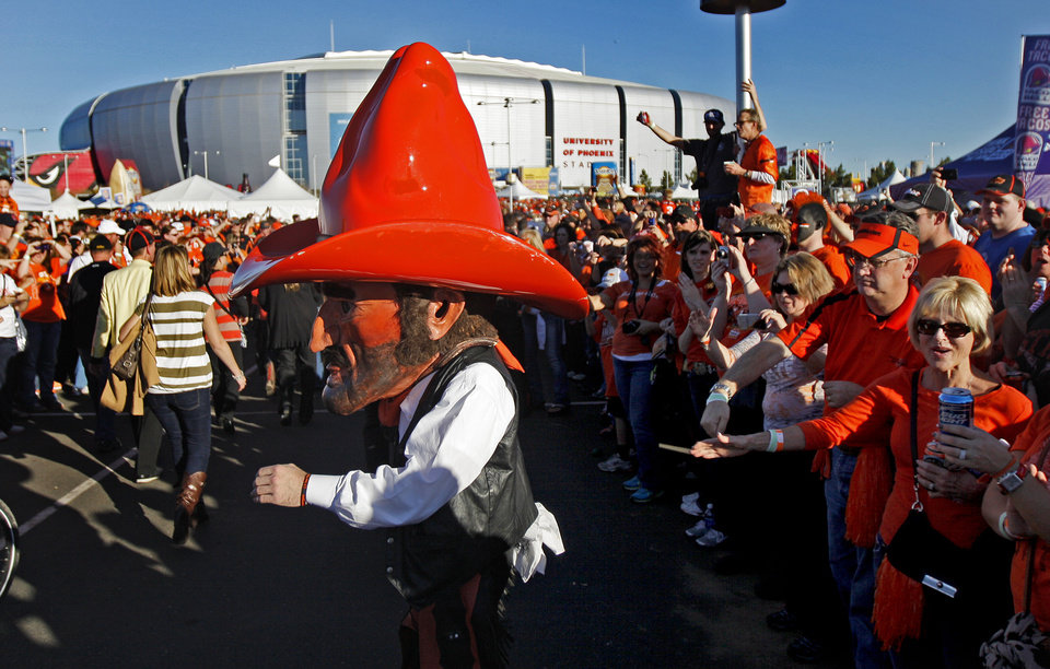 Photo - Pistol Pete greets fans before the Fiesta Bowl between the Oklahoma State University Cowboys (OSU) and the Stanford Cardinal at the University of Phoenix Stadium in Glendale, Ariz., Monday, Jan. 2, 2012. Photo by Bryan Terry, The Oklahoman