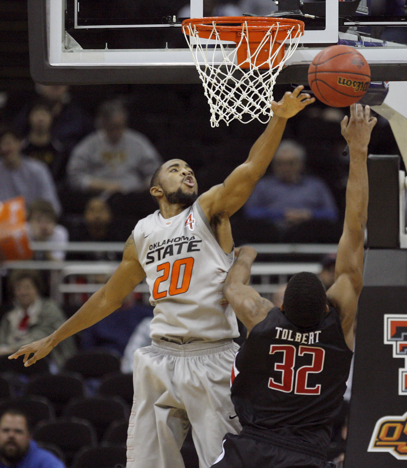 Oklahoma State's Michael Cobbins (20) defends against Texas Tech's Jordan Tolbert (32) during the Big 12 tournament men's basketball game between the Oklahoma State Cowboys and the Texas Tech Red Raiders at the Sprint Center, Wednesday, March, 7, 2012. Photo by Sarah Phipps, The Oklahoman