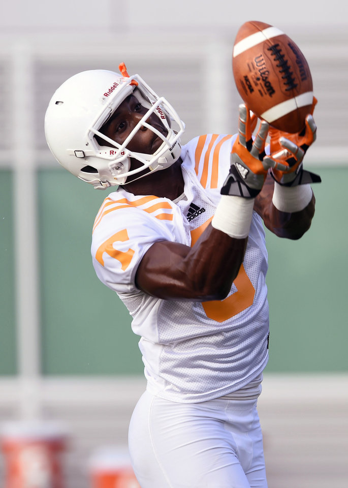 Photo - University of Tennesse wide receiver Marquez North reaches for a pass during the first football practice at Haslam Field, Friday, Aug. 1, 2014 in Knoxville, Tenn. (AP Photo/The Knoxville News Sentinel, Amy Smotherman Burgess)