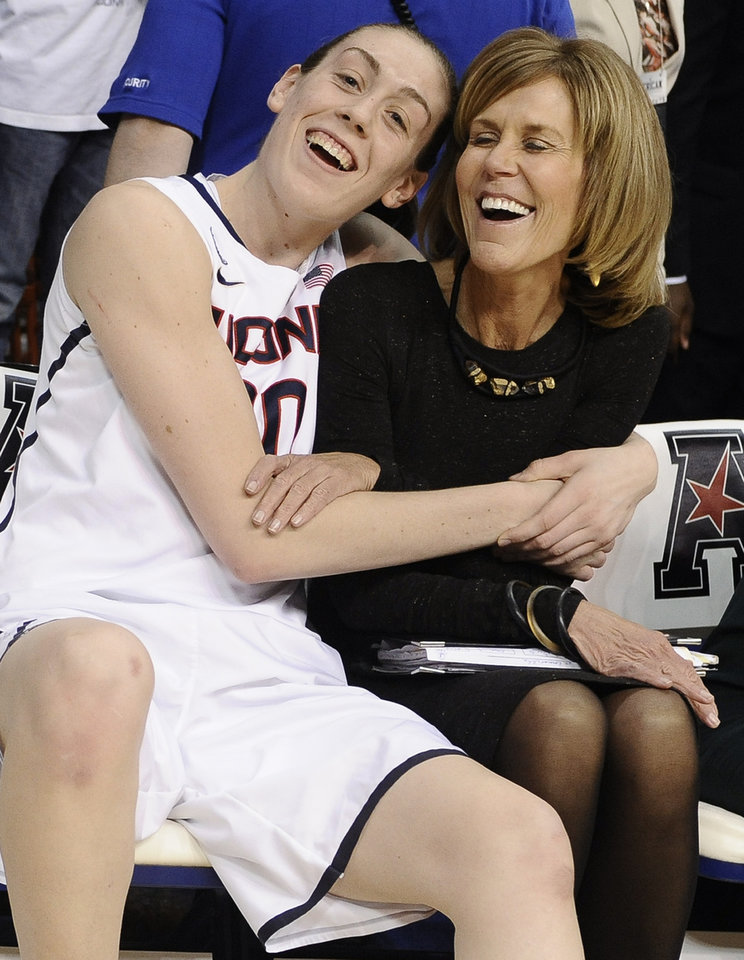Photo - Connecticut's Breanna Stewart, left, hugs associate head coach Chris Dailey after winning an NCAA college basketball game in the finals of the American Athletic Conference women's basketball tournament against Louisville, Monday, March 10, 2014, in Uncasville, Conn. Connecticut won 72-52. (AP Photo/Jessica Hill)