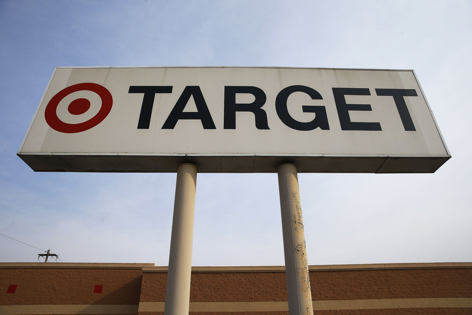 Photo - In this Tuesday, March 25, 2014 photo, a sign outside a Target store in Philadelphia is shown. Target said Monday, May 5, 2014, that Chairman, President and CEO Gregg Steinhafel is out, nearly five months after the retailer disclosed a massive data breach that hurt its reputation. The nation's third-largest retailer says Steinhafel has agreed to step down as the company's chairman, president and CEO, effective immediately. He also has resigned from its board of directors. (AP Photo/Matt Rourke)
