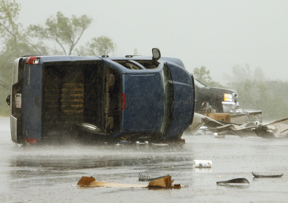 Overturned cars litter the parking lot of the Country Boy grocery store in Little Axe after a storm tore through the area on Monday, May 10, 2010, in Norman, Okla.  Photo by Steve Sisney, The Oklahoman