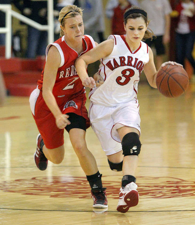 Washington's Amber Madden, right, tries to get past Kingston's Mikayla Wells during a girls high school basketball game in Washington, Okla., Friday, Feb. 17, 2012. Photo by Bryan Terry, The Oklahoman