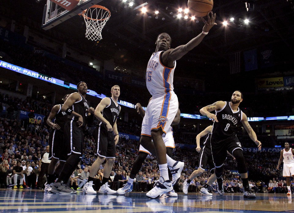 Photo - Thunder's Reggie Jackson (15) tries to save a rebound in the first half of an NBA basketball game where the Oklahoma City Thunder were defeated 95-93 by the Brooklyn Nets at the Chesapeake Energy Arena in Oklahoma City, on Thursday, Jan. 2, 2014. Photo by Steve Sisney The Oklahoman