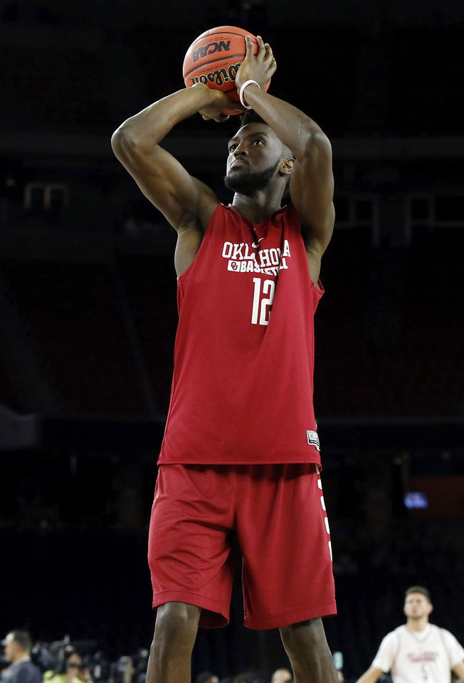 Photo - Oklahoma's Khadeem Lattin (12) shoots during practice on Final Four Friday before the national semifinal between the Oklahoma Sooners and the Villanova Wildcats in the NCAA Men's Basketball Championship at NRG Stadium in Houston, Friday, April 1, 2016. OU will play Villanova in the Final Four on Saturday. Photo by Nate Billings, The Oklahoman