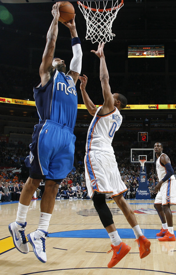 Photo - Drew Gooden of Dallas goes to the basket beside Oklahoma City's Russell Westbrook during the NBA basketball game between the Oklahoma City Thunder and the Dallas Mavericks at the Ford Center in Oklahoma City on Wednesday, December 16, 2009. Photo by Bryan Terry, The Oklahoman
