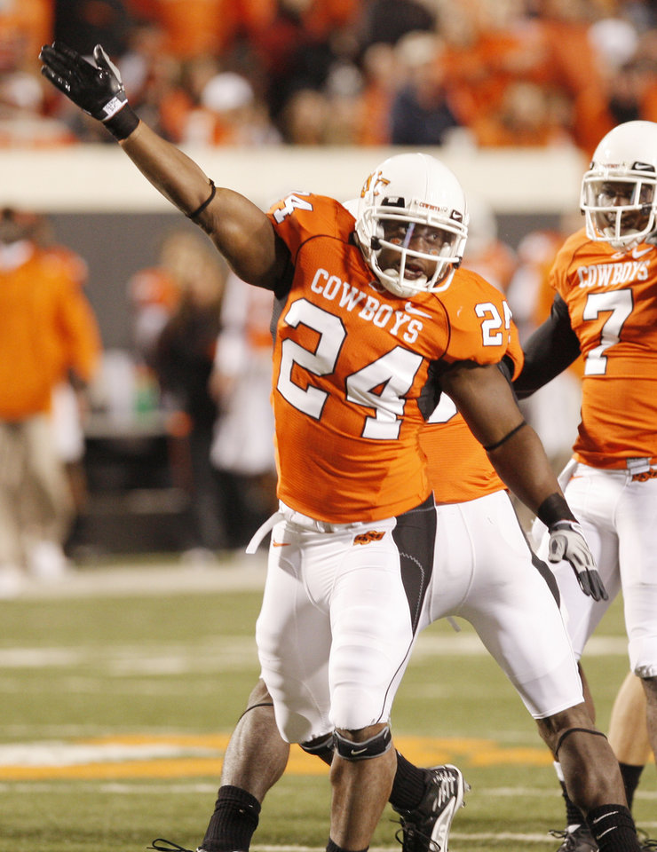 Photo - Deron Fontenot celebrates a fumble recovery by the Cowboys during the college football game between Oklahoma State University (OSU) and the University of Missouri (MU) at Boone Pickens Stadium in Stillwater, Okla. Saturday, Oct. 17, 2009.  Photo by Doug Hoke, The Oklahoman