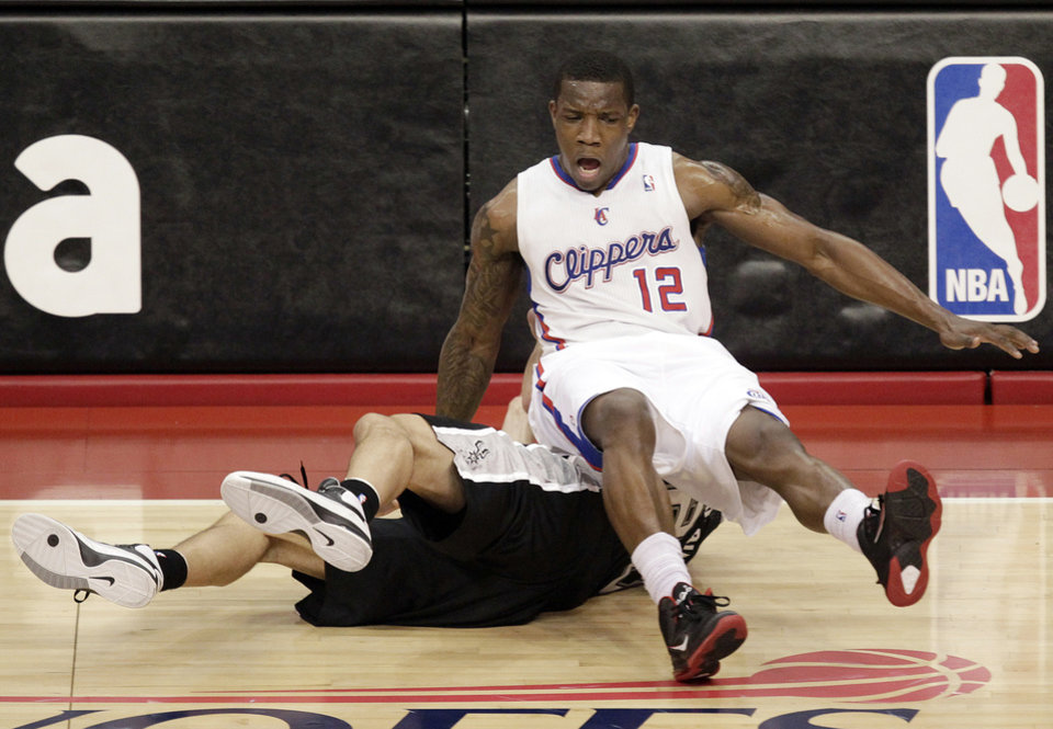 Los Angeles Clippers' Eric Bledsoe, top, collides with San Antonio Spurs' Manu Ginobili, of Argentina, during the first half in Game 4 of an NBA basketball playoffs Western Conference semifinal game in Los Angeles, Sunday, May 20, 2012. (AP Photo/Jae C. Hong)