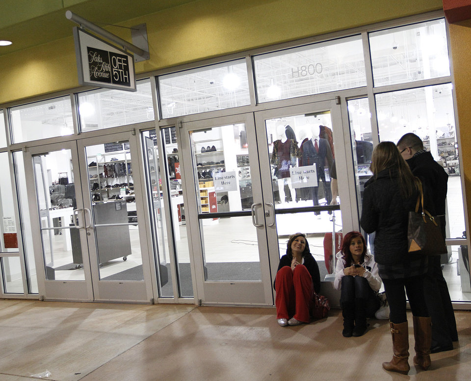 Photo - Presley Robbins, Emilia Bigham, Joe Reeder, and Emily Reeder wait outside of Saks Fifth Avenue OFF 5TH during Black Friday at The Outlet Shoppes at Oklahoma City, Thursday, Nov. 24, 2011.  Photo by Garett Fisbeck, For The Oklahoman