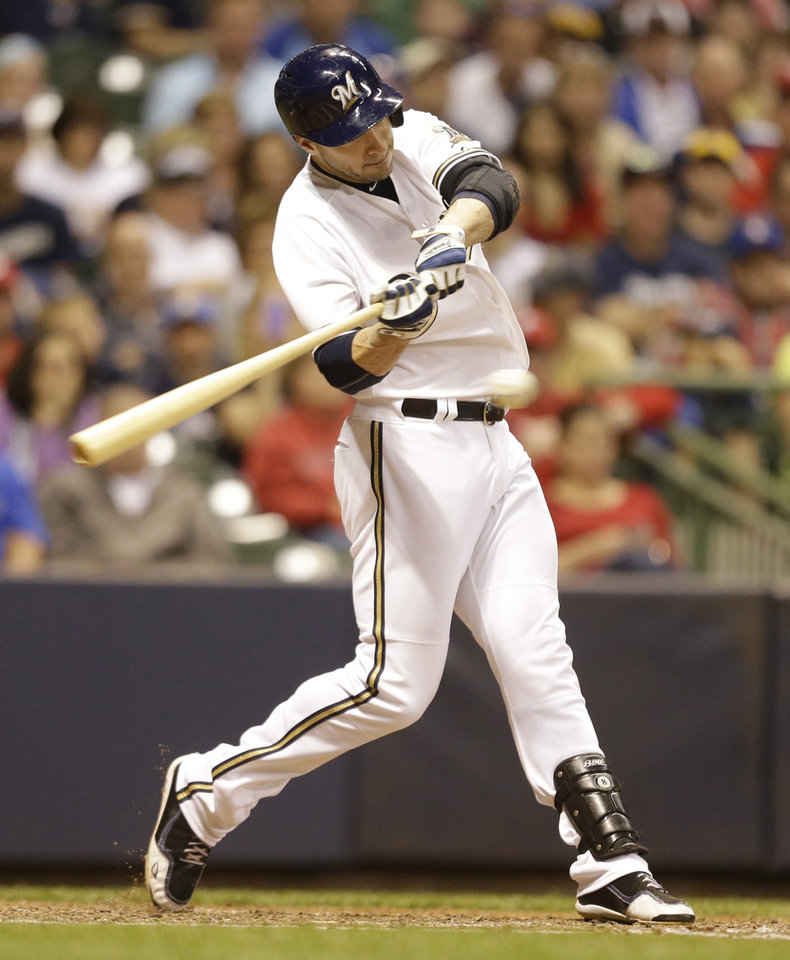 Photo - Milwaukee Brewers' Ryan Braun hits a two-run home run against the Cincinnati Reds in the eighth inning of a baseball game on Saturday, June 14, 2014, in Milwaukee. (AP Photo/Jeffrey Phelps)