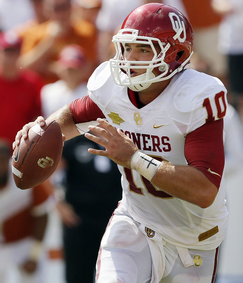 OU\'s Blake Bell (10) looks for a receiver during the Red River Rivalry college football game between the University of Oklahoma Sooners and the University of Texas Longhorns at the Cotton Bowl Stadium in Dallas, Saturday, Oct. 12, 2013. UT won, 36-20. Photo by Nate Billings, The Oklahoman