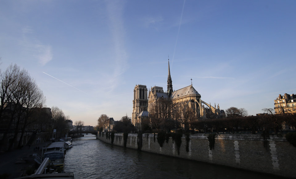 View of Paris' Notre Dame Cathedral as part of a ceremony for its 850th anniversary , Wednesday, Dec. 12, 2012. Paris' Notre Dame Cathedral is kicking off its 850th anniversary celebrations, which will include new bells for the medieval landmark, cast in a foundry in Normandy. (AP Photo/Christophe Ena) ORG XMIT: ENA109