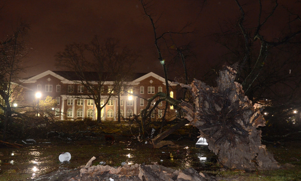 Trees lie uprooted in front of the University of Southern Mississippi campus in Hattiesburg, Miss., after an apparent tornado Sunday, Feb. 10, 2013. (AP Photo/Chuck Cook) ORG XMIT: LACC129