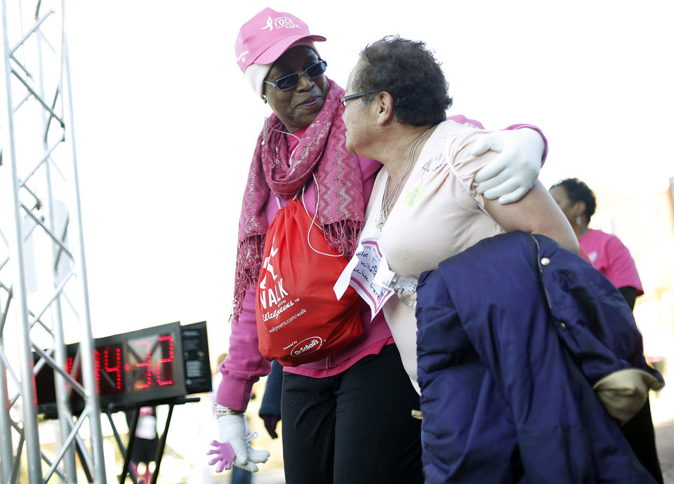 Jeannie Houston, left, helps Naomi Nojima cross the finish line during the 19th Annual Oklahoma City Race for the Cure at Chicasaw Bricktown Ballpark in Oklahoma City, Saturday, Oct. 27, 2012.  Photo by Garett Fisbeck, The Oklahoman