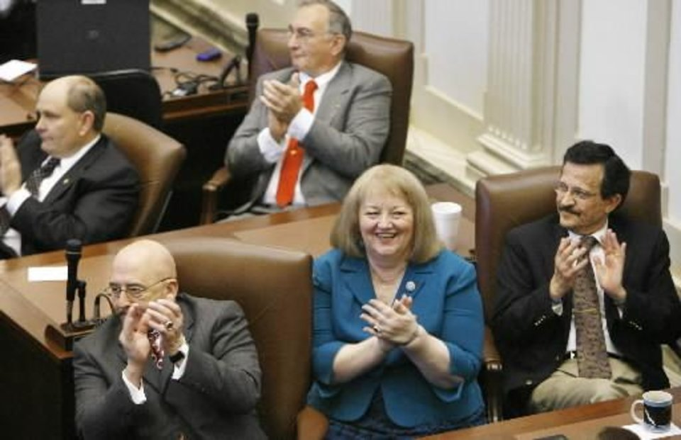Gov. Brad Henry addressed a joint session of the Oklahoma legislature in the House chamber Monday afternoon, Feb, 4, 2008. This marks the opening session of the second session of the state's 51st legislature. Lawmakers applaud the governor as he delivers his address. From left, in front are Rep. Al McAffrey, Sen.  Debbe  Leftwich and Rep. Al Lindley. BY JIM BECKEL