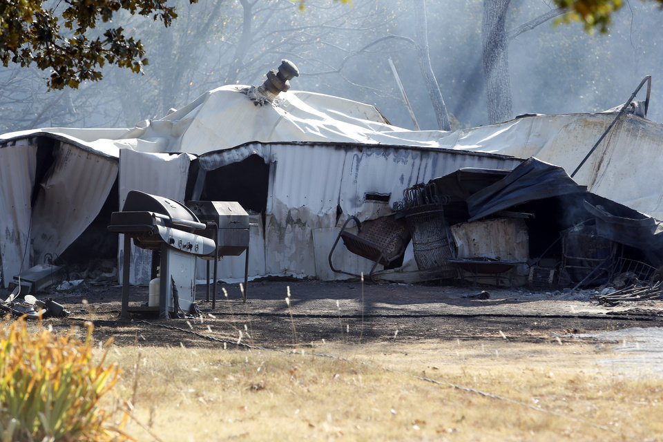 The remains of a mobile home on 132nd Street  still smolder from Friday's wildfire on Saturday, Aug. 4, 2012, in Slaughterville, Okla. Photo by Steve Sisney, The Oklahoman